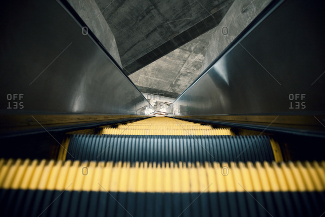 Close up of stairs on an escalator looking downward