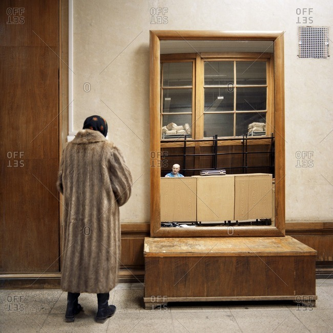 February 17, 2005: Woman in a fur coat standing in a hallway near a mirror