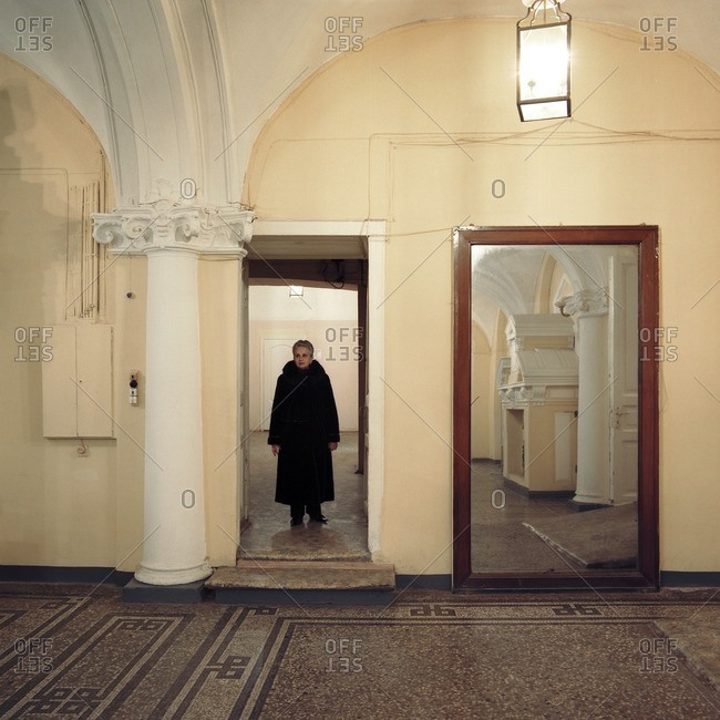 December 26, 2005: Woman standing in a doorway of a building wearing a long winter coat