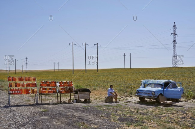 June 30, 2015: Man selling honey at a roadside stand in Uzbekistan