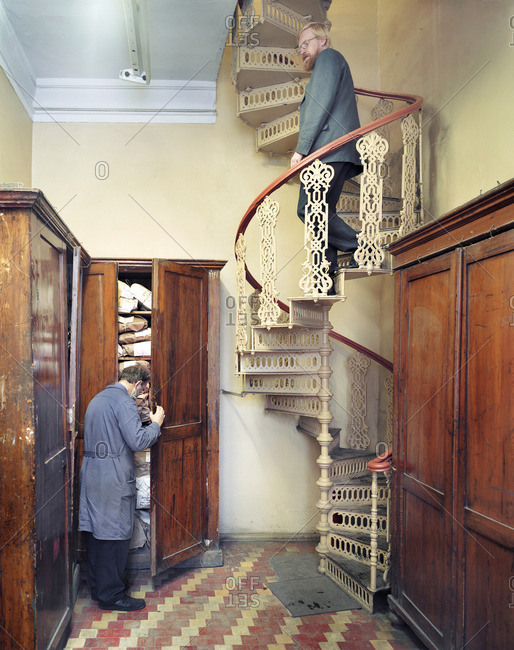 December 27, 2005: Man descending a spiral staircase in a building in Russia