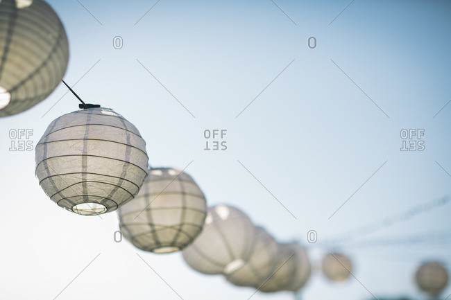 Paper lanterns in a line outside