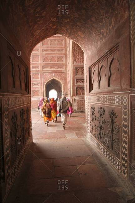 January 25, 2016: Group of women walking through an arched corridor at the Taj Mahal