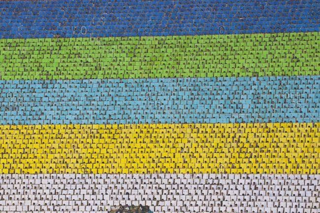 Rows of athletes with colored boards forming colorful stripes at the Arirang Mass Games in North Korea