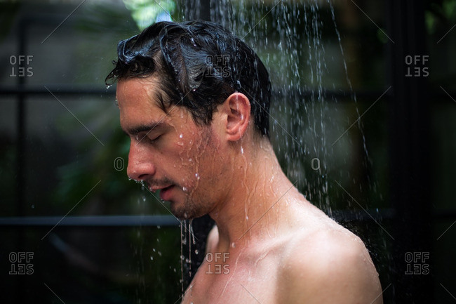 Man rinsing off in outdoor shower