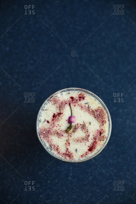 Frothy, creamy drink topped with crushed rose petals