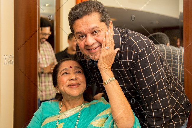 May 30, 2015: Asha Bhosle affectionately touches the cheek of man