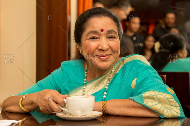 May 30, 2015: Asha Bhosle enjoying coffee