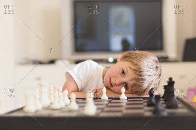 Young boy ponders his next chess move