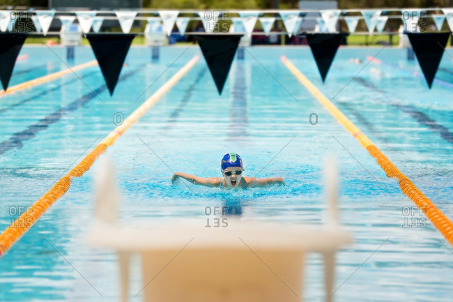 Girl swimming in competition