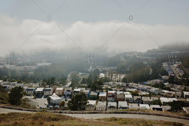 Suburban neighborhood streets with fog rolling in