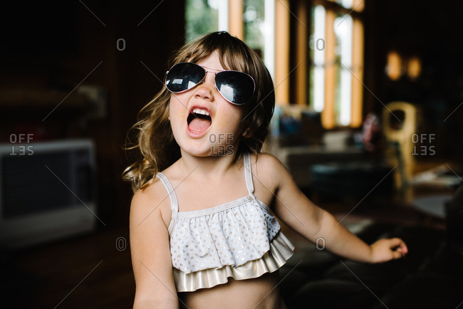 Little girl wearing aviator sunglasses