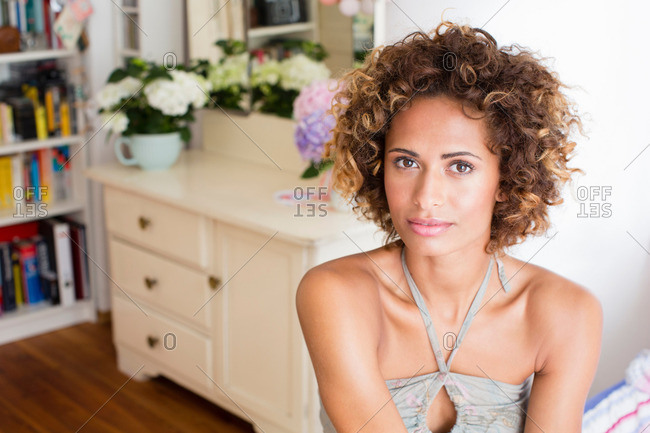 Woman sitting in bedroom