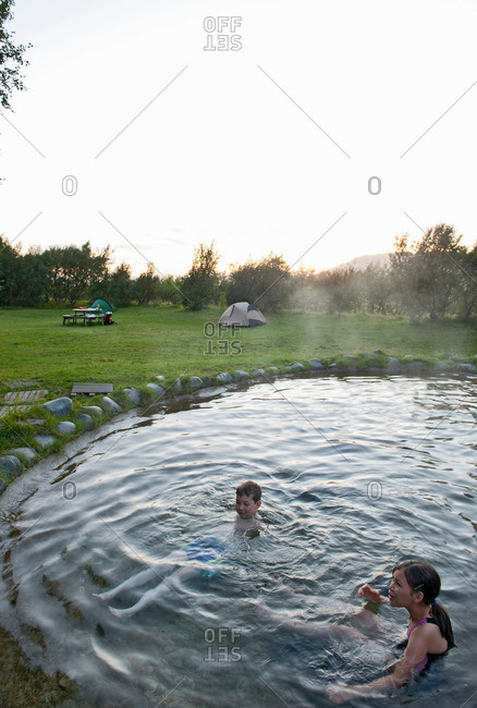 Family relaxing in natural hot spring