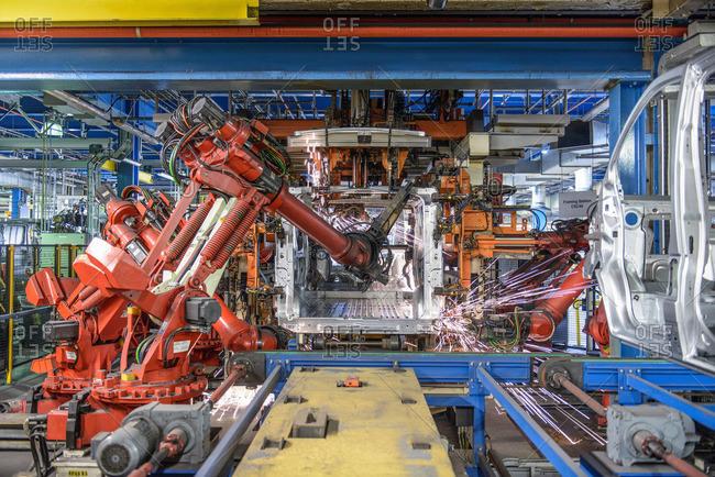 Robots welding van body