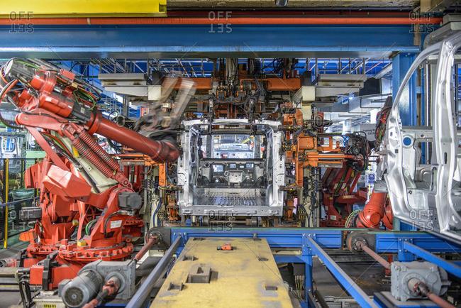 Robots welding van body in car plant