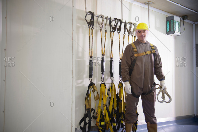 Portrait of worker wearing safety harness in food factory