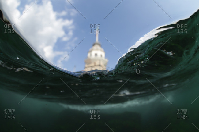 Tower in background with focus on waves in foreground