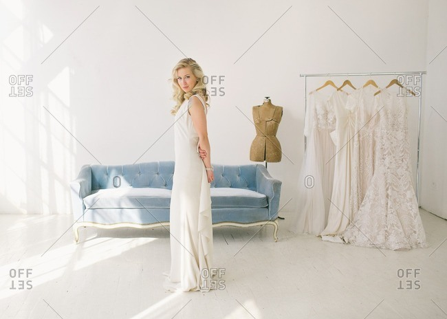 3/7/15: Portrait of a bride standing in a bridal showroom