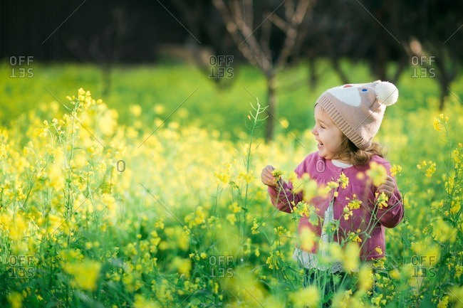 Girl standing in a field of wild flowers