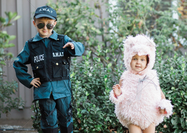Two children standing side-by-side wearing costumes