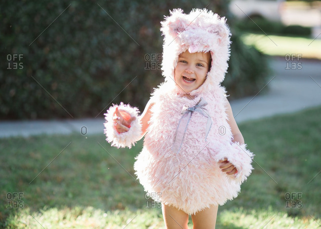 Girl standing outdoors wearing a costume