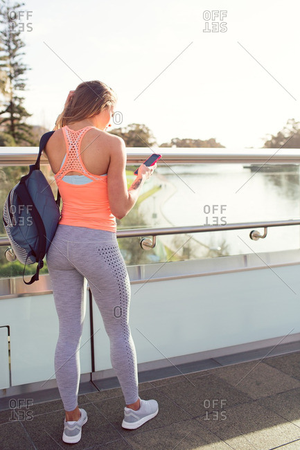 Woman in workout clothes with phone