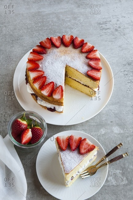 Overhead view of strawberry sponge cake on a table