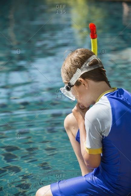 Boy wearing scuba mask at swimming-pool