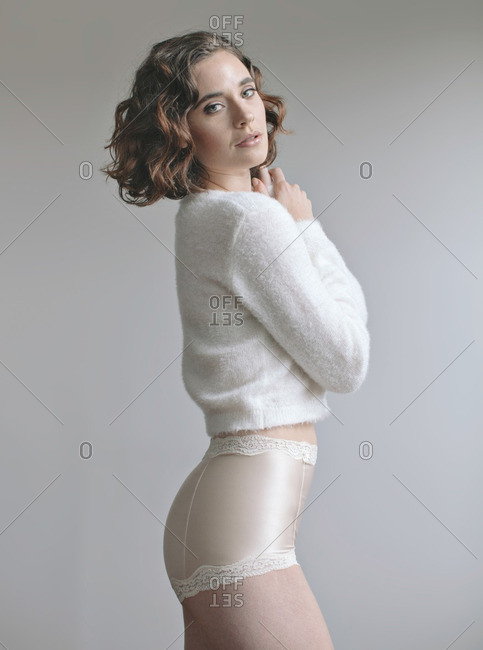 December 13, 2013: Model in sweater and panties