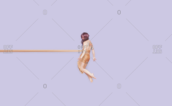 July 6, 2014: Woman floating in fabric roll