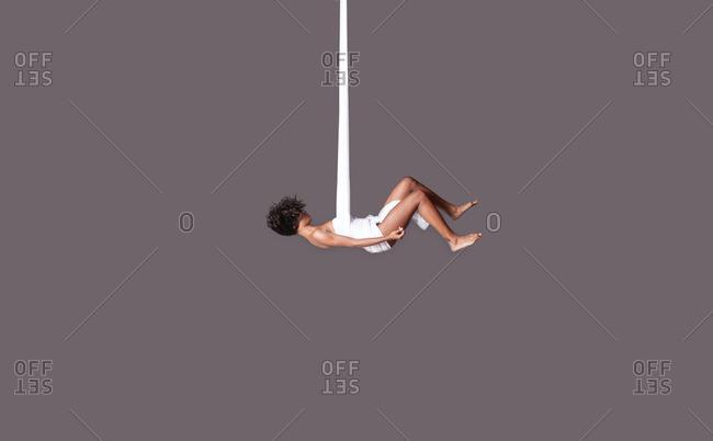 July 6, 2014: Woman dangling in fabric