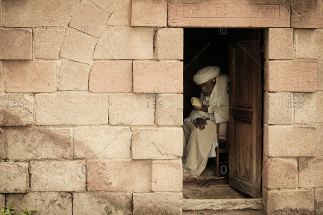 August 22, 2011: Old man in Ethiopia reading