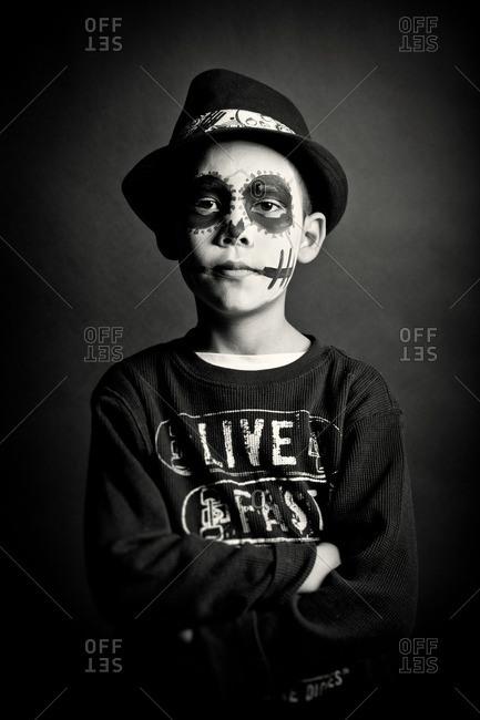 November 3, 2011: Boy in hat in skeleton makeup