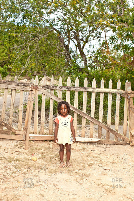 July 27, 2012: Young Jamaican girl by fence