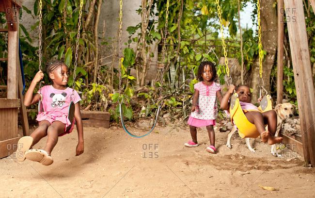 July 27, 2012: Kids on swings in Jamaica