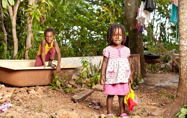 July 27, 2012: Jamaican kids by sink outside