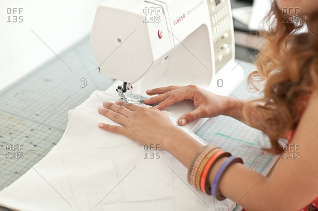 July 10, 2012: Woman sewing cloth at machine