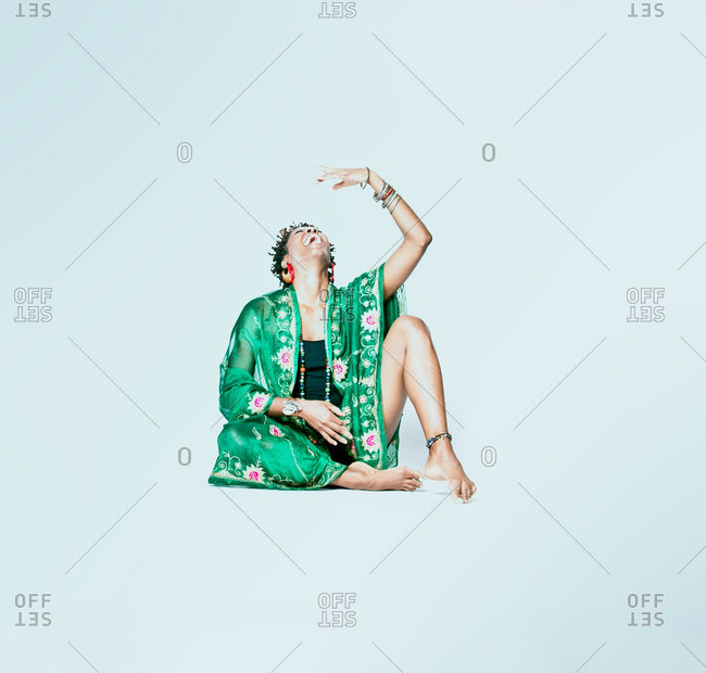 December 6, 2012: A woman in robe doing yoga