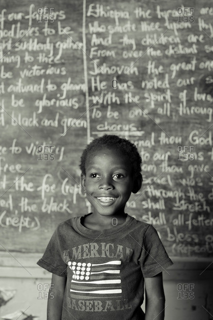 July 27, 2012: A smiling boy by blackboard