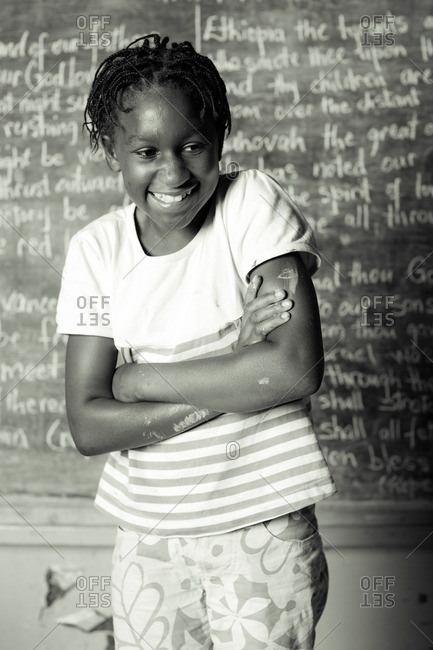 July 27, 2012: Smiling girl by a chalkboard