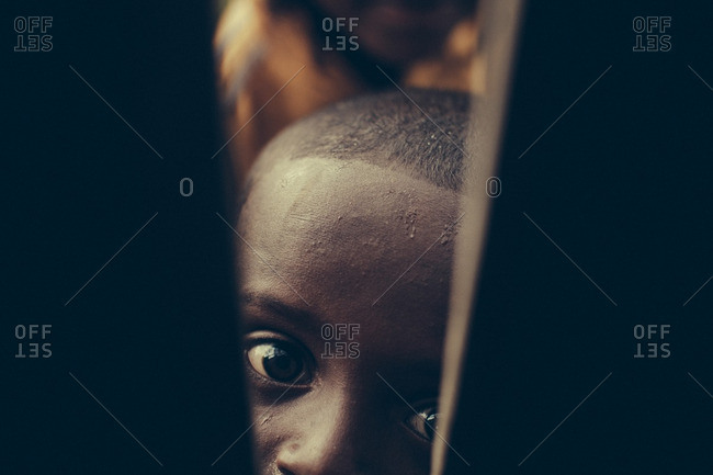 September 21, 2013: Ethiopian boy looking through fence