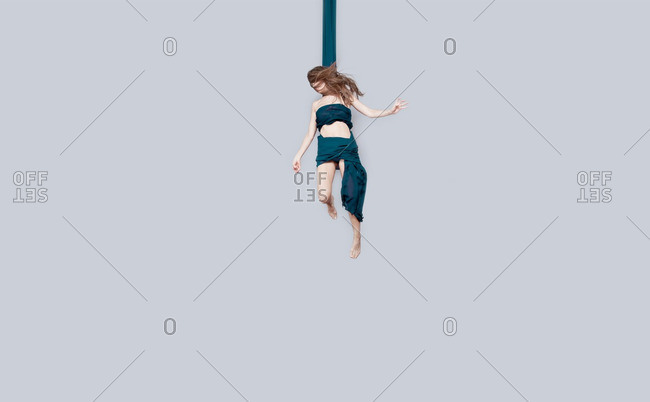 July 13, 2014: A woman hanging by cloth