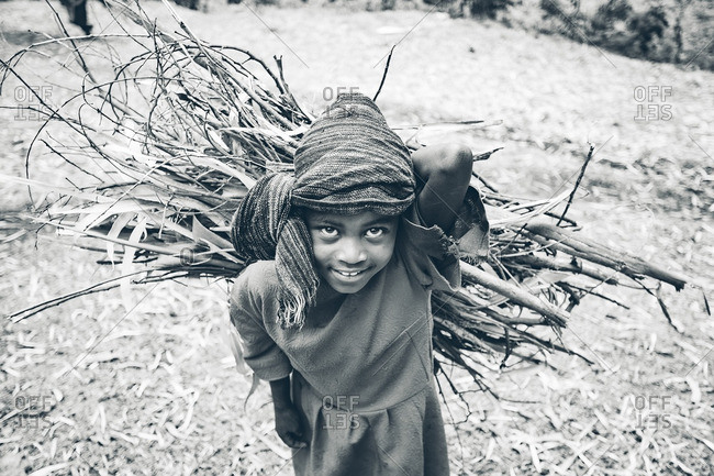 March 29, 2012: Ethiopian girl carrying sticks