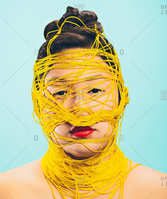 October 16, 2015: Asian woman wrapped in string