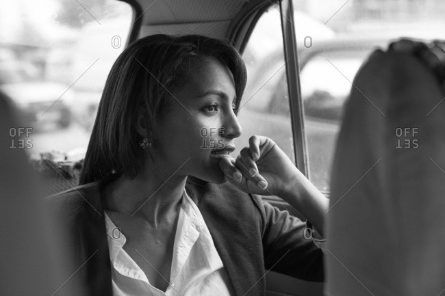 September 26, 2013: Professional woman in car