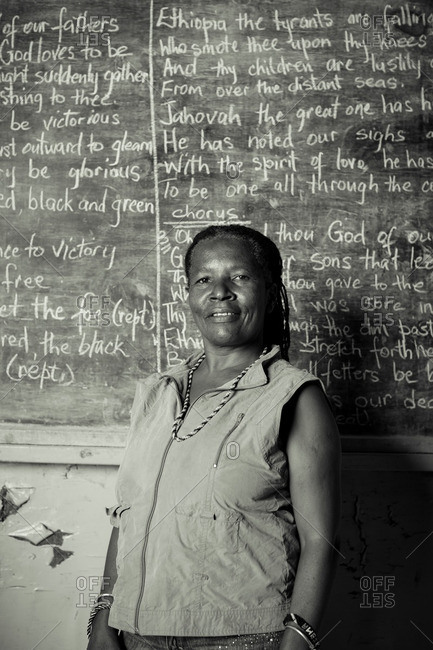 July 27, 2012: Woman by chalkboard, Jamaica