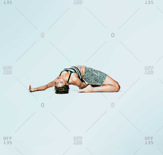 December 6, 2012: Woman kneeling and bending backwards