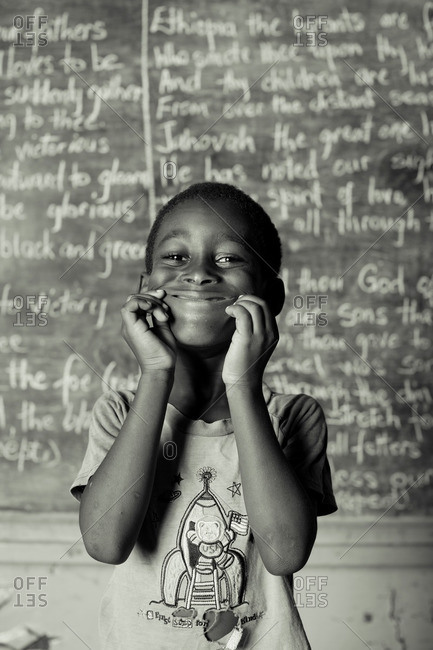July 27, 2012: Grinning Jamaican boy by chalkboard