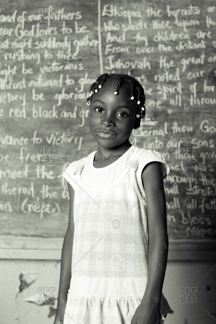 July 27, 2012: Smiling Jamaican girl by chalkboard